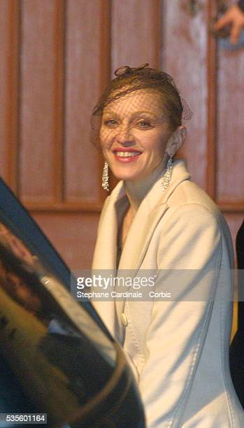 Madonna smiling during the christening of her son Rocco in Dornoch Cathedral