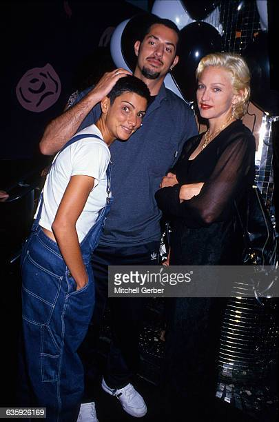 Madonna stands with friends Ingrid Casares and Guy Osceary at a party for Vibe Magazine