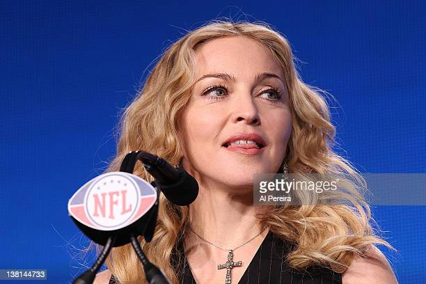 Madonna sticks out her tongue when she attends the Bridgestone Super Bowl XLVI Halftime Show Press Conference at the Super Bowl XLVI Media Center on...