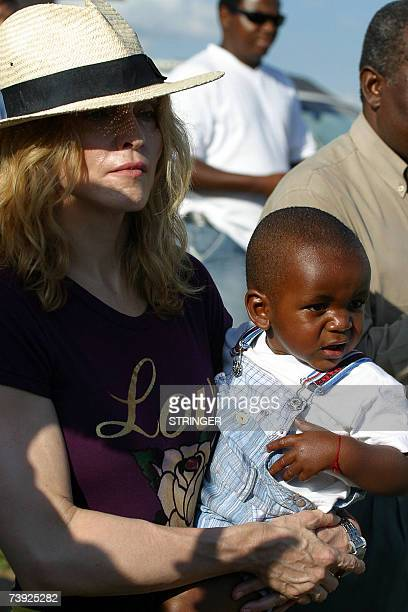 Madonna the Queen of Pop poses with her Malawian son David Banda in Mphandula 19 April 2007 Madonna urged Malawian youths to work hard to realise...