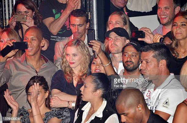 Madonna watches dancer Brahim Zaibat performing during the Closing Party of the Gotha Club of Palm Beach Casino on August 27 2011 Cannes France