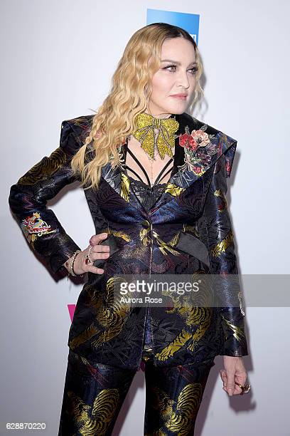 Madonna wearing custom Gucci Suit attends Billboard Women in Music 2016 at Pier 36 on December 9 2016 in New York City