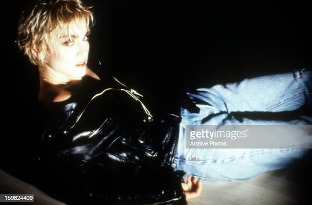Madonna with a seductive look on her face as she leans back in a scene from the film 'Desperately Seeking Susan' 1985