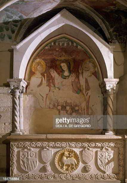 Madonna with Child and two Saints fresco by Giovanni di Francia from the tomb Passasepe Lambertini Crypt of Santa Maria della Scala Cathedral of...