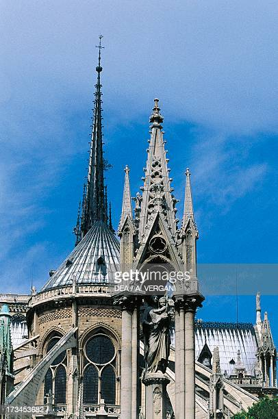 Madonna with Child, spire on the outside of the apse of Notre-Dame Cathedral , Paris , Ile-de-France, France.
