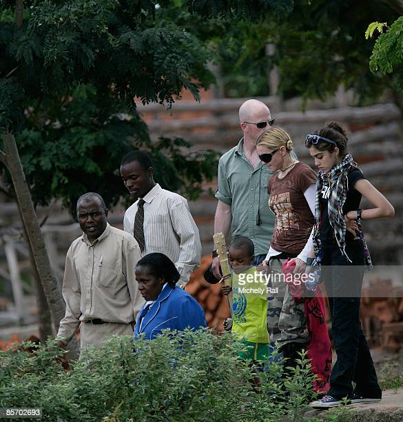 Madonna with her daughter Lourdes Leon and her adopted son David Banda visits a project previously set up by her Raising Malawi Foundation at the...