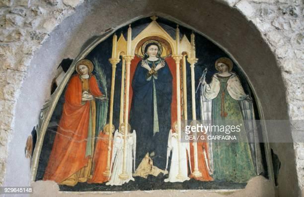 Madonna with Saints Agnes and Apollonia basilica of Santa Maria di Collemaggio L'Aquila Abruzzo Italy 15th century