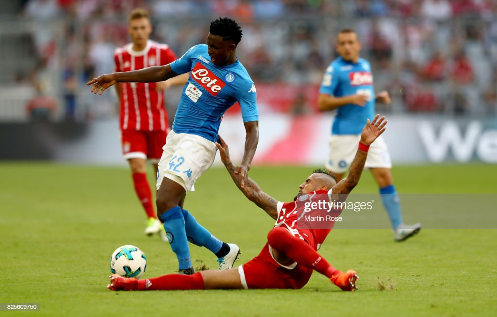 Madou Diawara (L) of Napoloi and Arturo Vidal of Muenchen battle for the ball during the Audi Cup 2017 match between SSC Napoli and FC Bayern Muenchen at Allianz Arena on August 2, 2017 in Munich, Germany.