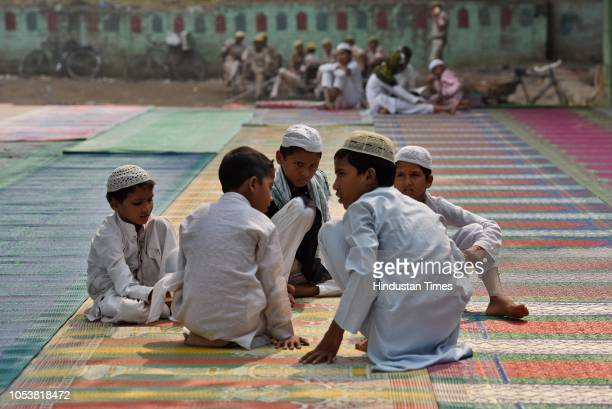 Madrasa boys sits in the compound of Jamia Faridya Jama Masjid after an eightyearold student of a Madrasa died after he sustained a head injury...