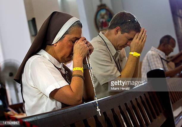 Madre Adela Galindo from the Order of Corazones Traspazados de Maria y Jesus of Miami prays to the original statue of Our Lady of Charity located in...