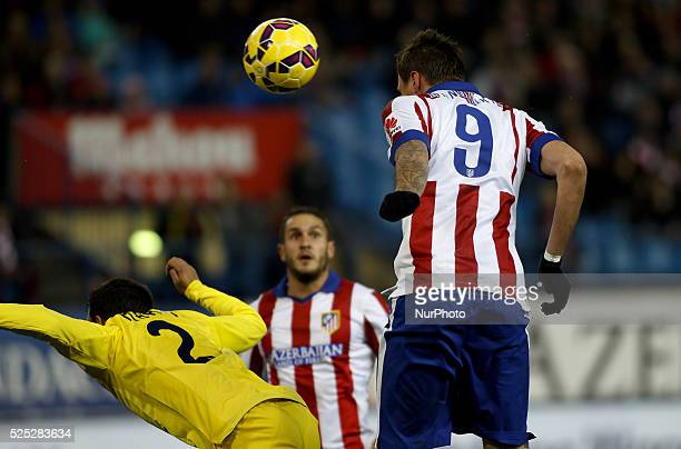 Atletico de Madrid's Croatian forward Mario Mandzukic and Villareal CFs Spanish Defender player Mario Gaspar during the Spanish League 2014/15 match...