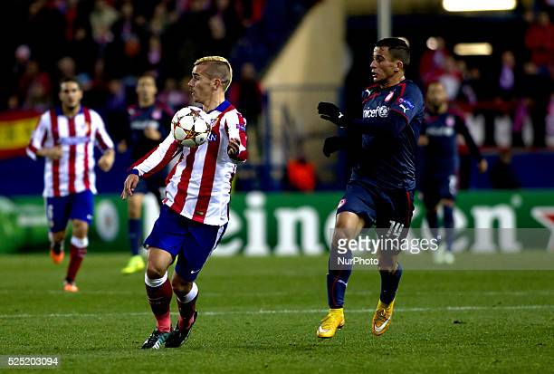 Atletico de Madrid's French forward Antoine Griezmann and Olympiacos Norwegian Defender Omar Elabdellaoui during the Champions League 2014/15 match...
