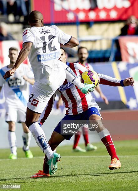 Atletico de Madrid's Mexican forward Raul Jimenez and Deportivo de la Coru��as defender payer Sidnei Rechel Da Silva during the Spanish League...