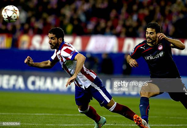 Atletico de Madrid's Spanish midfielder Raul Garcia and Olympiacos Spanish Defender Alberto Botia during the Champions League 2014/15 match between...