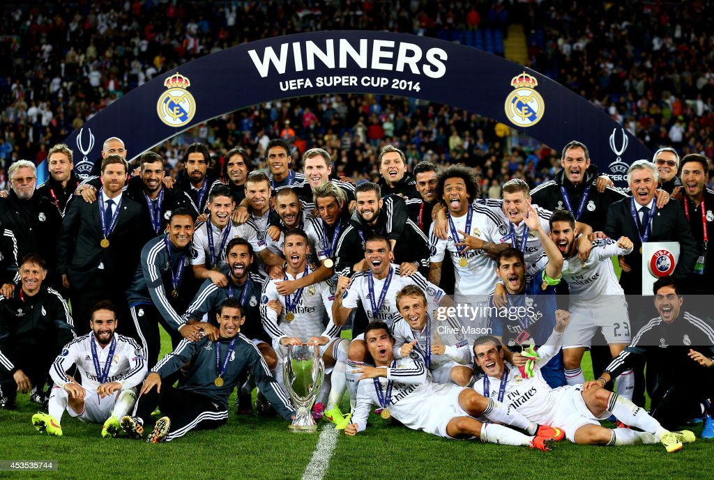 Madrid celebrate following their 2-0 victory during the UEFA Super Cup between Real Madrid and Sevilla FC at Cardiff City Stadium on August 12, 2014 in Cardiff, Wales.