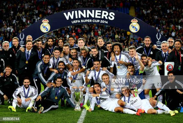 Madrid celebrate following their 20 victory during the UEFA Super Cup between Real Madrid and Sevilla FC at Cardiff City Stadium on August 12 2014 in...