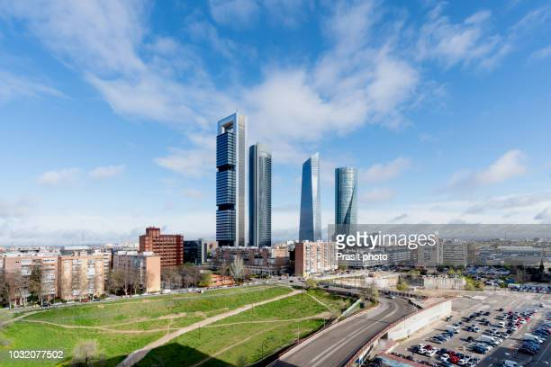 madrid cityscape at daytime. landscape of madrid business building at four tower. modern high building in business district area at spain. - madrid - fotografias e filmes do acervo