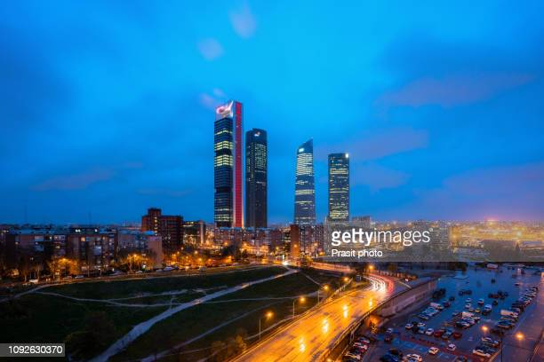 Madrid Four Towers financial district skyline at twilight in Madrid, Spain.