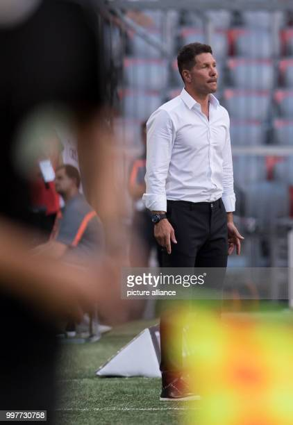 Madrid head coach Diego Simeone follows the game from the sidelines during the Audi Cup semifinal match pitting Atletico Madrid vs SSC Napoli in the...
