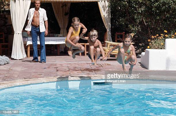 Madrid July 1971 in his palace of the Zarzuela Prince Juan Carlos of Spain open shirt over jeans watches his three children Elena Cristina and FELIPE...