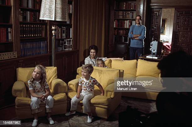 Madrid July 1971 Juan Carlos of Spain at his home in his palace of the Zarzuela standing dressed in a sweater with sleeves rolled up watching a...