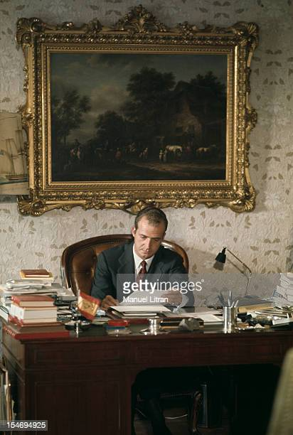 Madrid July 1971 Juan Carlos of Spain working sitting behind his desk at his home in his palace of the Zarzuela