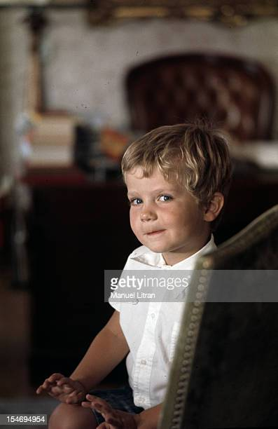 Madrid July 1971 Looking malicious FELIPE the young prince of Spain three years sitting in a chair in the office of his father at the Zarzuela Palace
