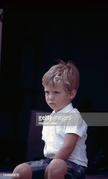 Madrid July 1971 Prince Felipe of Spain three years in shorts sitting on steps looking into space