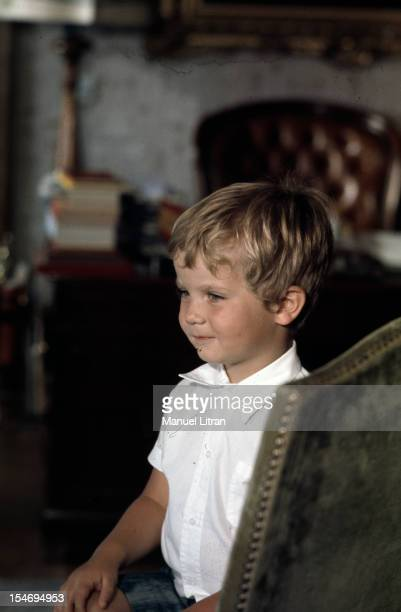 Madrid July 1971 the young Prince Felipe of Spain three years sitting in a chair in the office of his father at the Zarzuela Palace