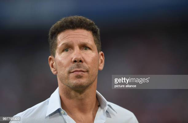 Madrid manager Diego Simeone goes to the bench before kickoff of the Audi Cup final Atletico Madrid vs FCLiverpool match in the Allianz Arena in...