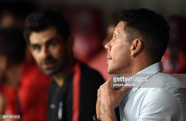 Madrid manager Diego Simeone sits on the bench before kickoff of the Audi Cup final Atletico Madrid vs FCLiverpool match in the Allianz Arena in...