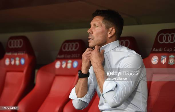 Madrid manager Diego Simeone sits on the bench during the Audi Cup final soccer match between Atletico Madrid and FC Liverpool in the Allianz Arena...