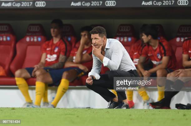 Madrid manager Diego Simeone watches from the touchline during the Audi Cup final soccer match between Atletico Madrid and FC Liverpool in the...