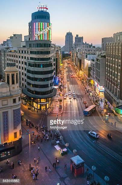 Madrid nightlife busy Gran Via iconic Schweppes neon sign Spain