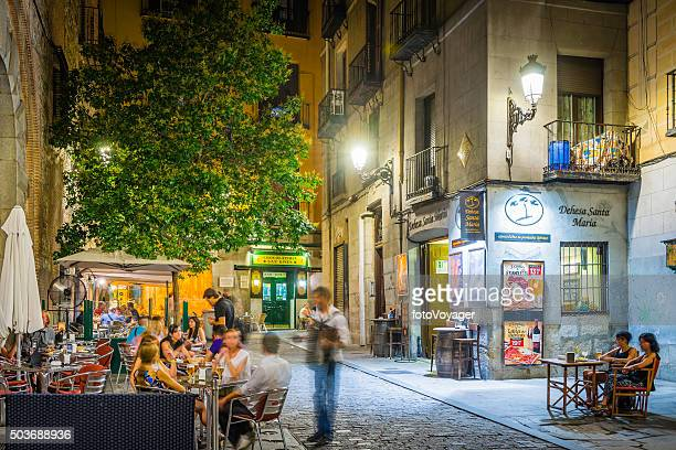 Madrid people relaxing al fresco restaurants warm night cafes Spain