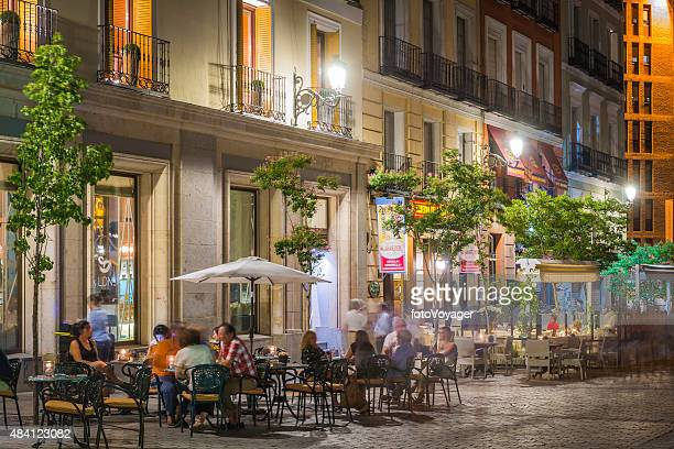 Madrid people relaxing at pavement cafes bars restaurants night Spain