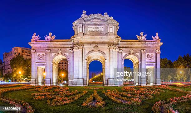 madrid puerta de alcala iconic monumental gate illuminated dusk spain - madrid stock pictures, royalty-free photos & images