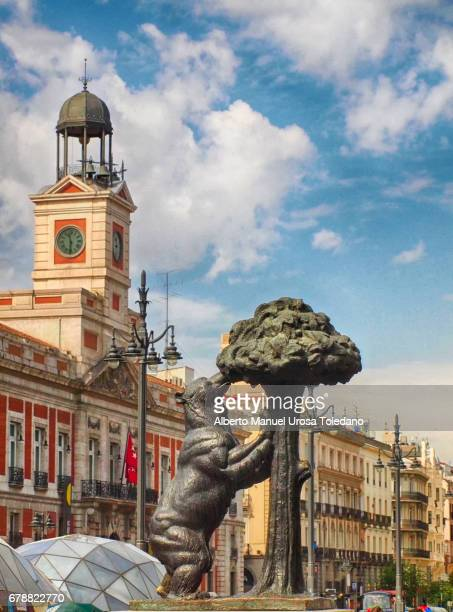 madrid, puerta del sol sq and bear statue - blue bear stock photos and pictures