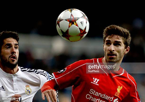 Real Madrid's Spanish midfielder Isco Alarcon and Liverpools Italian Forward player Fabio Borini during the Champions League 2014/15 match between...