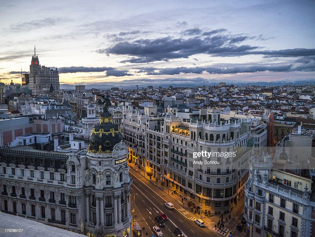 Madrid skyline, Gran Vía at dusk : Stock Photo