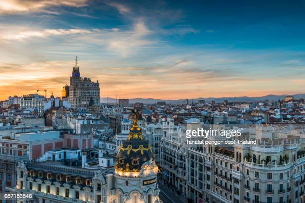 madrid skyline, gran vía at dusk - madrid stock pictures, royalty-free photos & images