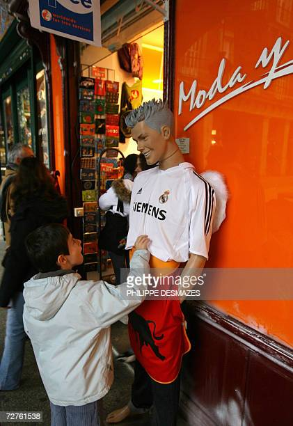 A boy looks at a Real Madrid shirt on show at a gift shop in Madrid 07 December 2006 According to an article published today in the French newspaper...