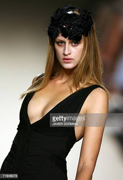 A model displays an outfit by Spanish designer Lydia Lozano part of her Spring/Summer 2007 collection at Madrid fashion week 20 September 2006 AFP...