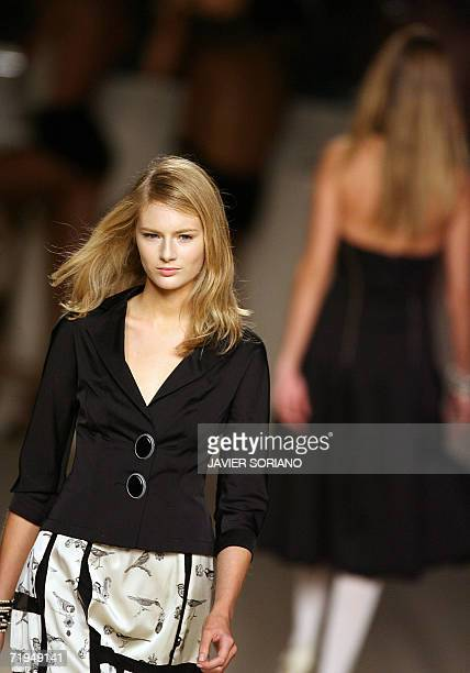 Model displays an outfit by Spanish designer Lydia Lozano, part of her Spring/Summer 2007 collection at Madrid fashion week, 20 September 2006. AFP...