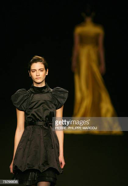 A model displays an outfit by Spanish designer Miriam Orcariz part of her Fall/Winter 2007 collection at Madrid fashion week 12 February 2007 AFP...