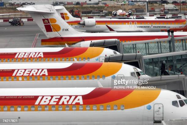A passenger boards an airplane of Spanish carrier Iberia 22 May 2007 at Barajas airport in Madrid British Airways has teamed up with a consortium led...