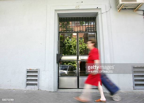 A woman walks in front of the building where the Spanish police arrested Islamic extremists in Madrid 15 June 2005 Spanish authorities have arrested...