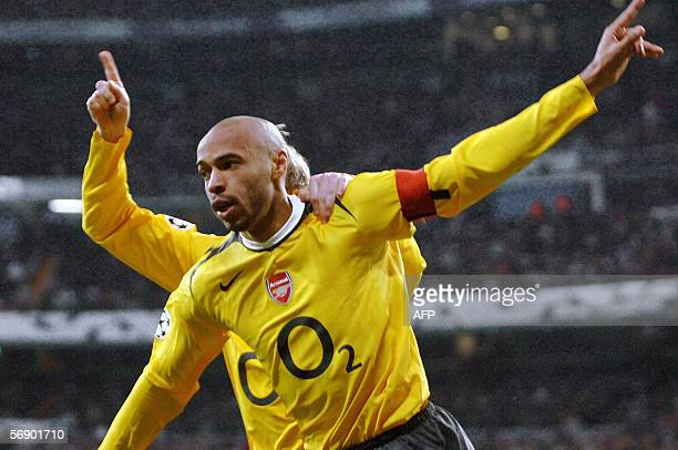 Arsenal's Frenchman Thierry Henry and Alexander Hleb celebrate after Henry's goal during their Champions League football match between Real Madrid...