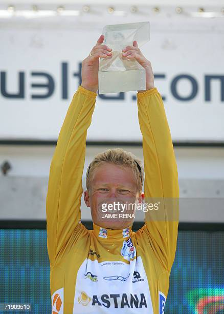 Astana rider Alexandre Vinokourov holds aloft the trophy after winning the Tour of Spain in Madrid 15 September 2006 For the 33yearold Astana team...