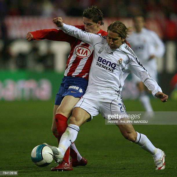 Atletico de Madrid's Fernando Torres vies with Real Madrid's Spanish defender Michel Salgado during a Spanish league football match at the Vicente...